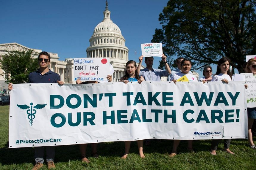 Protesters against the US Senate Republicans' healthcare bill holding a rally outside the US Capitol in Washington, DC.