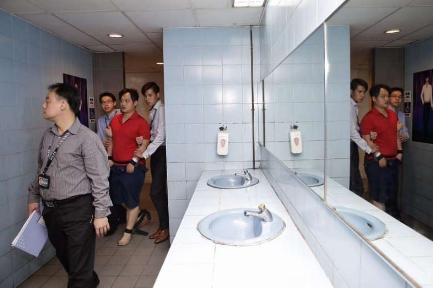 Taiwanese Chen Peng-Yu, 34, assisting the police with investigations in the men's toilet at Parklane Shopping Centre on July 19, 2017.