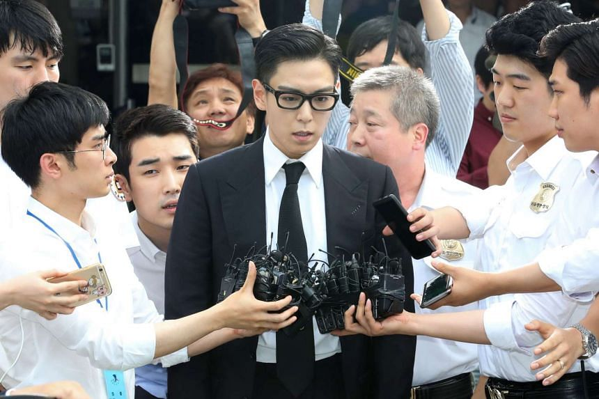 South Korean pop star T.O.P leaves after his trial at the Seoul Central District Court in Seoul on July 20. He received on July 20 a 10-month suspended jail sentence for smoking marijuana multiple times last year.