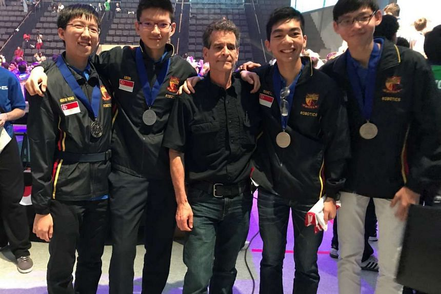 The ACS (I) boys - (from left) Tan Hsien Rong, Aron Choo, Isaac Lee and Caven Chia - pose with their medals and First founder Dean Kamen.