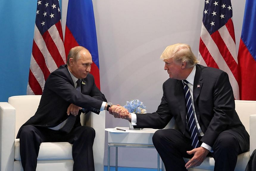 Russian President Vladimir Putin (left) and US President Donald J. Trump (right) shake hands during their meeting on the sidelines of the G20 summit in Hamburg, Germany on July 7, 2017.