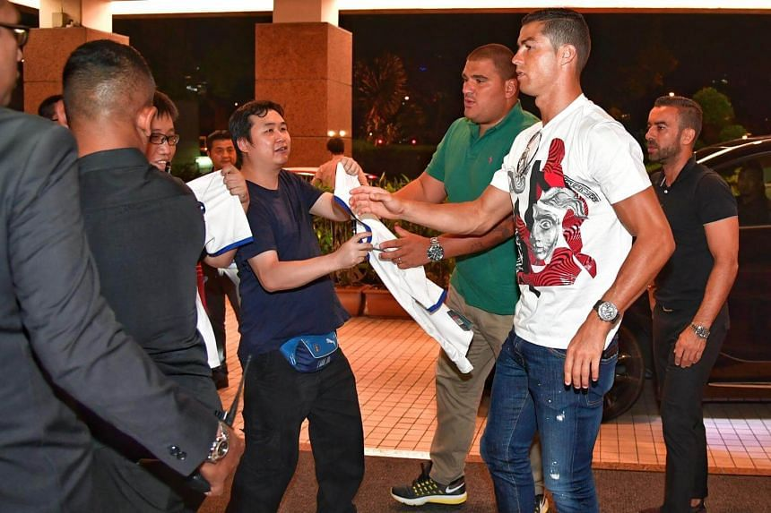 Fans approached Cristiano Ronaldo for autograph and was spotted at Great World City in Singapore on July 21, 2017.