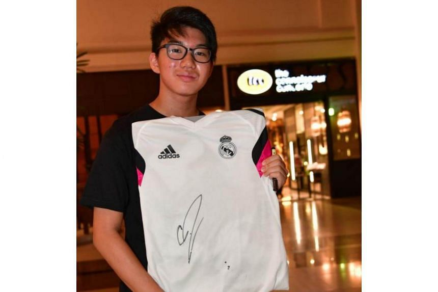 Jonathan Cheong , 16, shows the signed autographs of Cristiano Ronaldo where he was spotted at Great World City in Singapore in the evening of July 21, 2017 and to dine in Kuriya Dining.