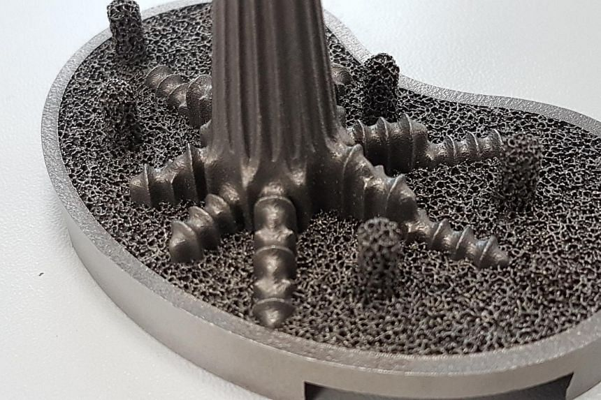 A metal component of a knee implant. 3D printers use a high powered laser to fuse powered material together. These printers can be used to create metal or polymer parts of high complexity that may be different or costly to manufacture using other mea