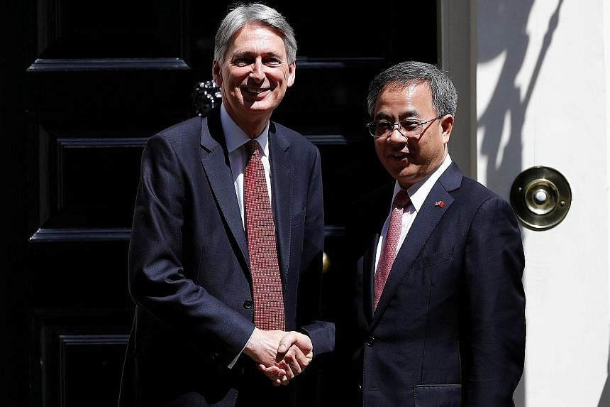 British Chancellor of the Exchequer Philip Hammond with Mr Hu Chunhua outside 11 Downing Street in London during the Guangdong party chief's visit to Britain last month. Such trips are often used by senior Chinese officials to burnish their internati