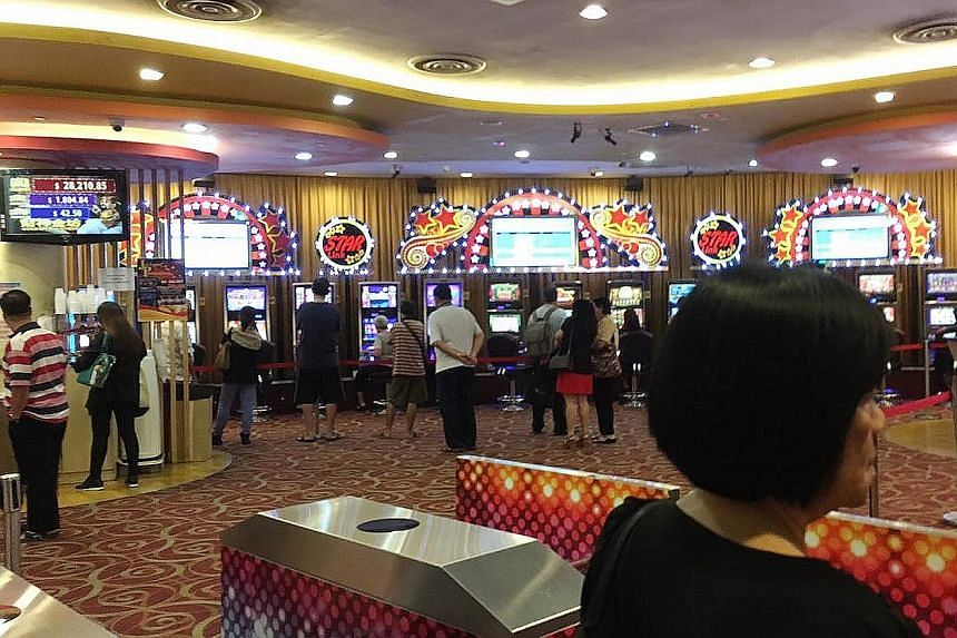 The jackpot room at Scarlet City, a clubhouse run by NTUC Club, in Ang Mo Kio Hub. For football clubs sitting out the S-League, they say jackpot income is needed to clear debts incurred from their days of playing professional football.