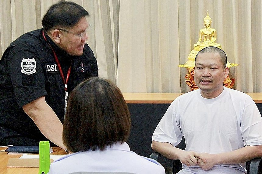Former Thai monk Wiraphon Sukphon being questioned by the authorities in Bangkok on Wednesday.