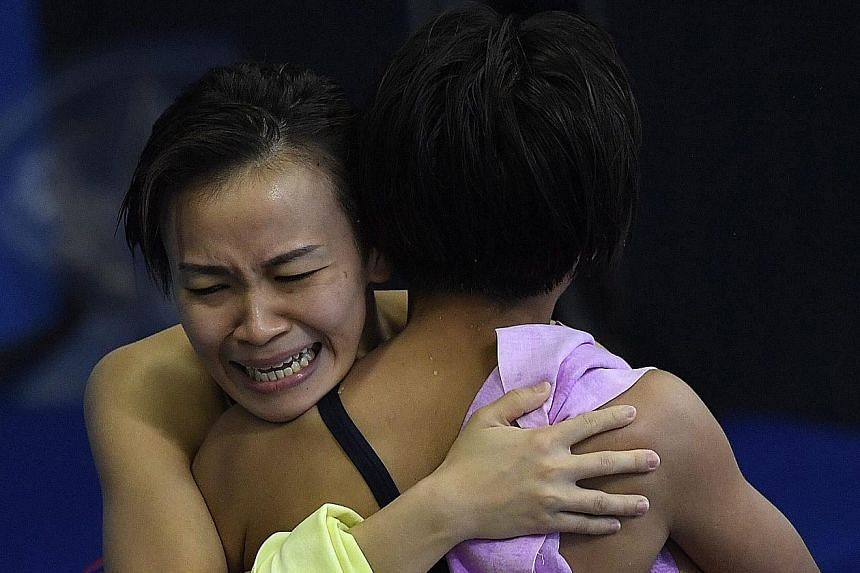 "From top: Cheong Jun Hoong of Malaysia on her way to the gold medal in the women's 10m platform event at the World Aquatics Championships in Budapest, Hungary. Cheong is overcome by emotion after her victory. Initially, she had hoped to ""maybe"" finis"