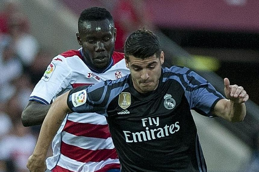 Real Madrid forward Alvaro Morata getting the better of Granada midfielder Victorien Angban during a LaLiga match last season. The Spaniard scored 15 league goals in that campaign.
