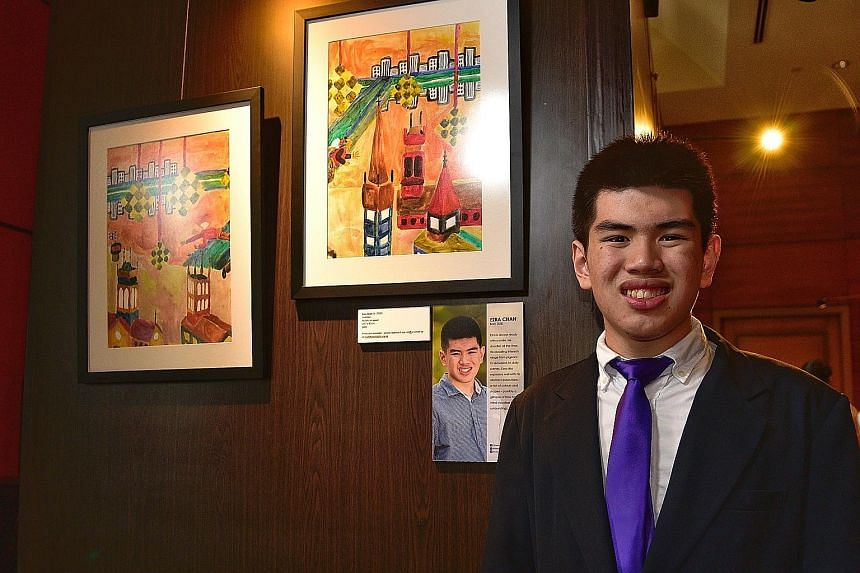 Mr Ezra Chan Yi with his works of art at Pathlight School's exhibition, Art For Autism: All Things Singapore, at Fullerton Hotel yesterday. This year's exhibition features the work of a total of 33 students and alumni, and is centred on how they view