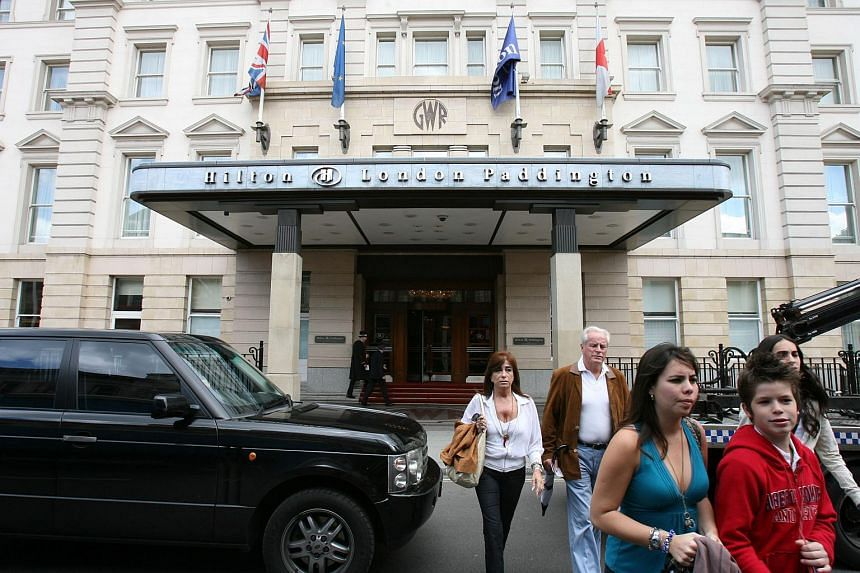 Hotel guests cross the street outside the Hilton Hotel at Paddington in London, on July 4, 2007.