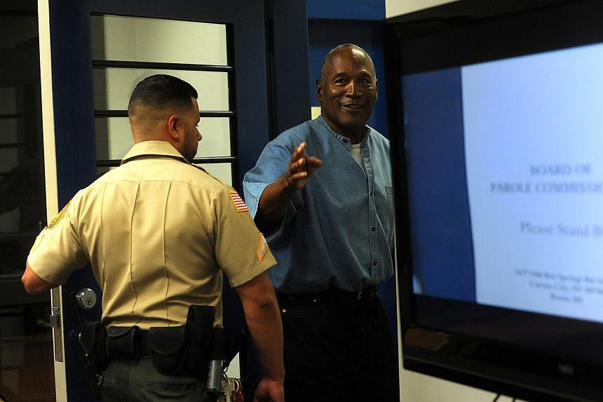 O.J. Simpson reacts after learning he was granted parole at Lovelock Correctional Center in Nevada on July 20, 2017.
