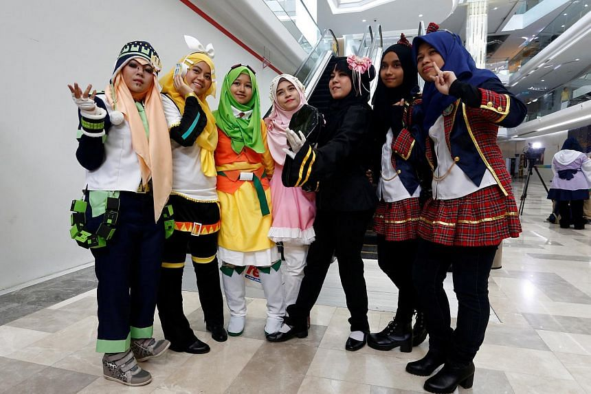 Muslim women cosplayers pose during a cosplay event at a mall in Petaling Jaya, near Kuala Lumpur, Malaysia on July 8, 2017.