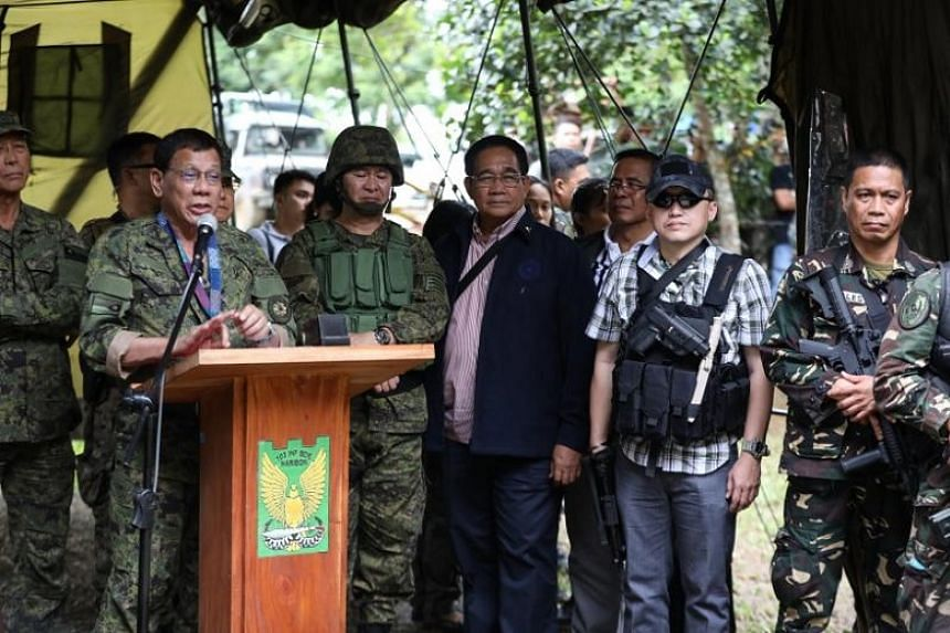 A handout photo of Philippine President Rodrigo Duterte speaking to government troops during a visit at a military camp in Marawi city, southern Philippines, on July 20, 2017.