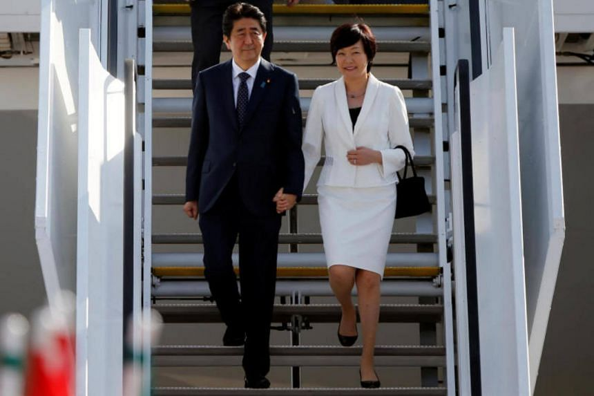 Japanese Prime Minister Shinzo Abe and his wife Akie arrive for the G20 leaders summit in Hamburg, on July 6, 2017.