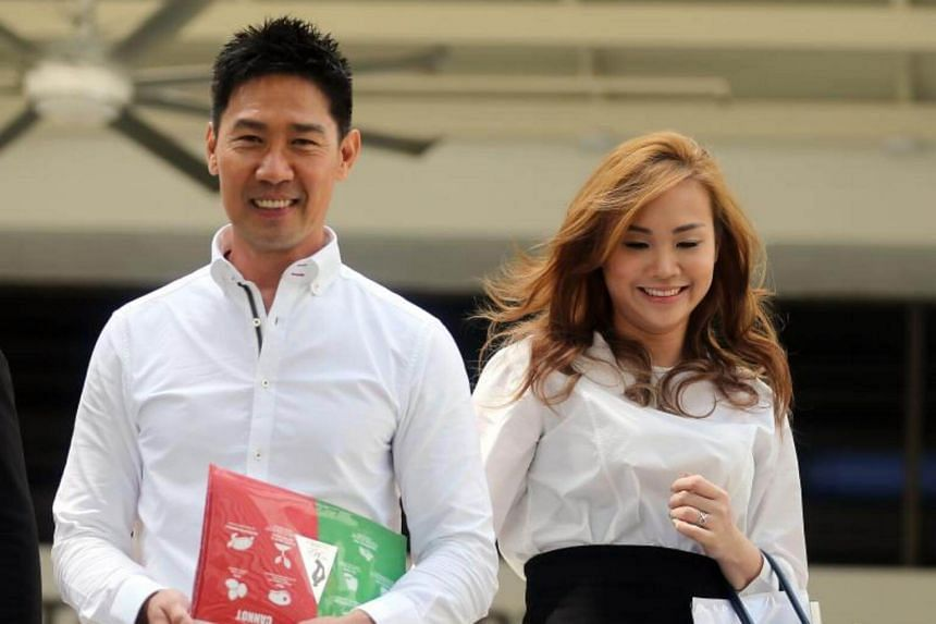 Edmund Chen and Karen Ho leaving the State Courts on July 21, 2017.