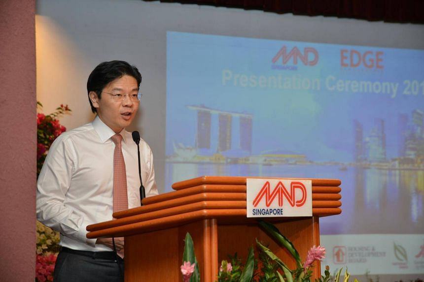 Minister for National Development Lawrence Wong addressing the scholarship recipients at the MND Auditorium in Maxwell Road.