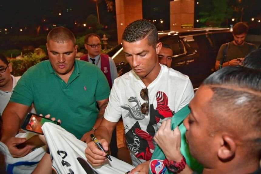 Cristiano Ronaldo signing autographs for fans at Great World City on the evening of July 21, 2017.
