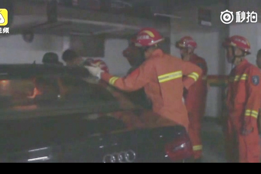 Firefighters were heard asking the woman to make a decision on which window to smash.