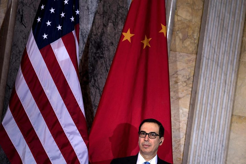 US Secretary of the Treasury Steven Mnuchin waits for a US and China comprehensive Economic Dialogue at the US Department of the Treasury on July 19, 2017.