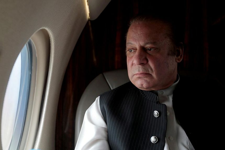 Pakistani Prime Minister Nawaz Sharif looks out the window of his plane after attending a ceremony to inaugurate the M9 motorway between Karachi and Hyderabad, Pakistan on Feb 3, 2017.