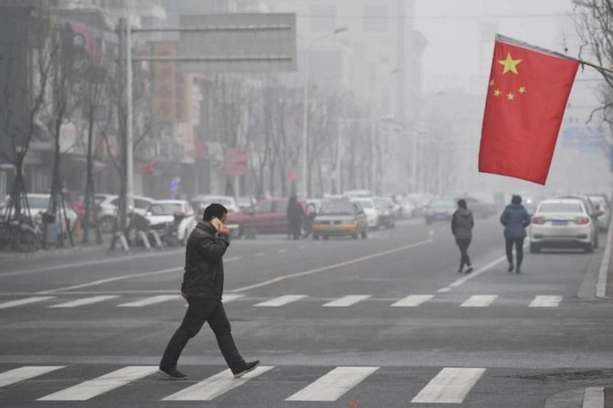 A man crossing a road in Shijiazhuang, Hebei province, on Dec 21, 2016.