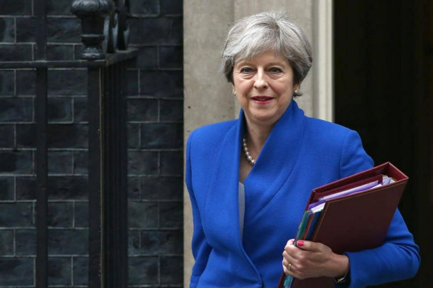 Britain's Prime Minister Theresa May leaves Downing Street in London, Britain, on July 19, 2017.
