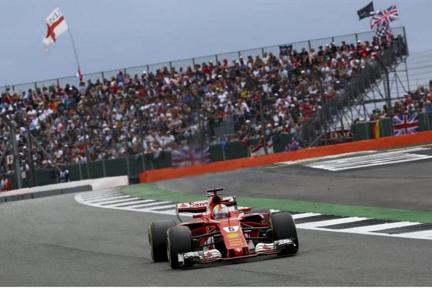 Sebastian Vettel exits Stowe corner during the Formula One Grand Prix of Great Britain at the Silverstone circuit, on July 16, 2017.