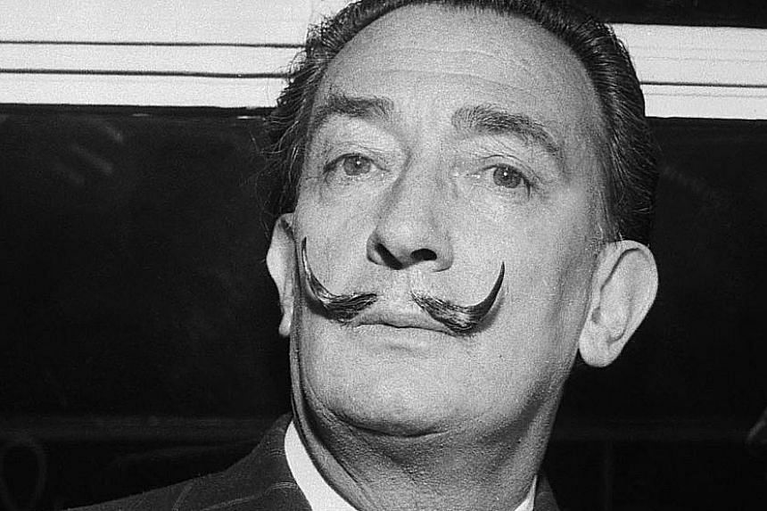 The arduous task of exhuming the body of Salvador Dali (above) involved removing a slab weighing more than a tonne that covered his tomb at the Dali Theatre-Museum (left) in Figueres, Spain.