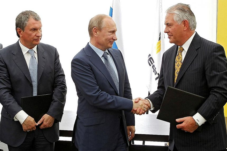 (From left) Rosneft head Igor Sechin, Russia President Vladimir Putin and former ExxonMobil chief executive Rex Tillerson at a signing ceremony at a Rosneft refinery in the Black Sea town of Tuapse, Russia, on June 15, 2012. Mr Tillerson, who is the