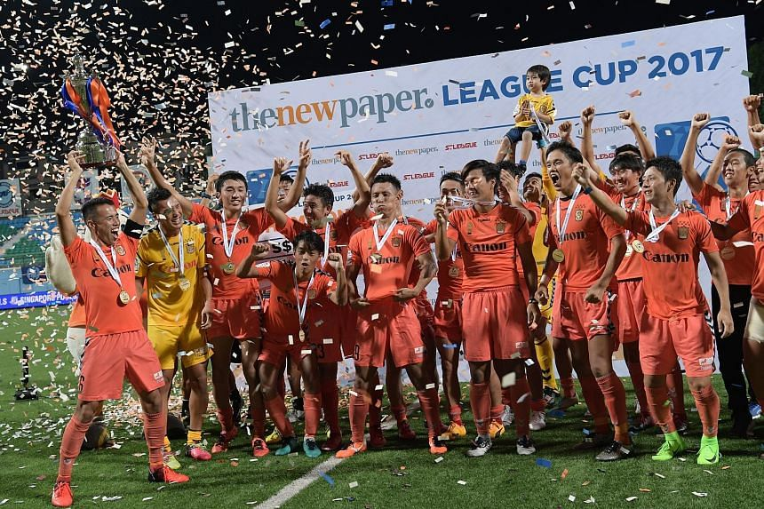 Albirex Niigata players celebrating after their extra-time victory over Warriors FC at the Jalan Besar Stadium last night.