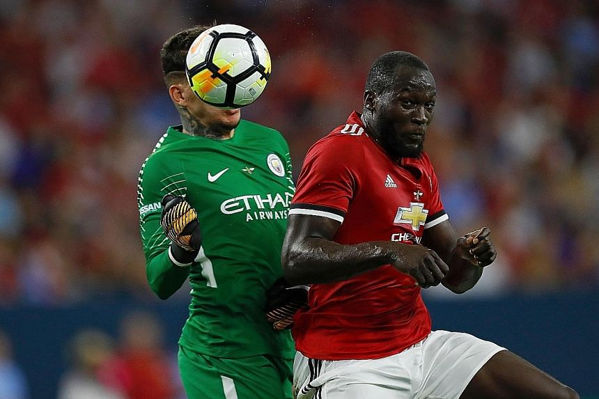 Manchester United striker Romelu Lukaku hitting a header past Manchester City goalkeeper Ederson before scoring during the International Champions Cup match in Houston, Texas. United won the game 2-0.