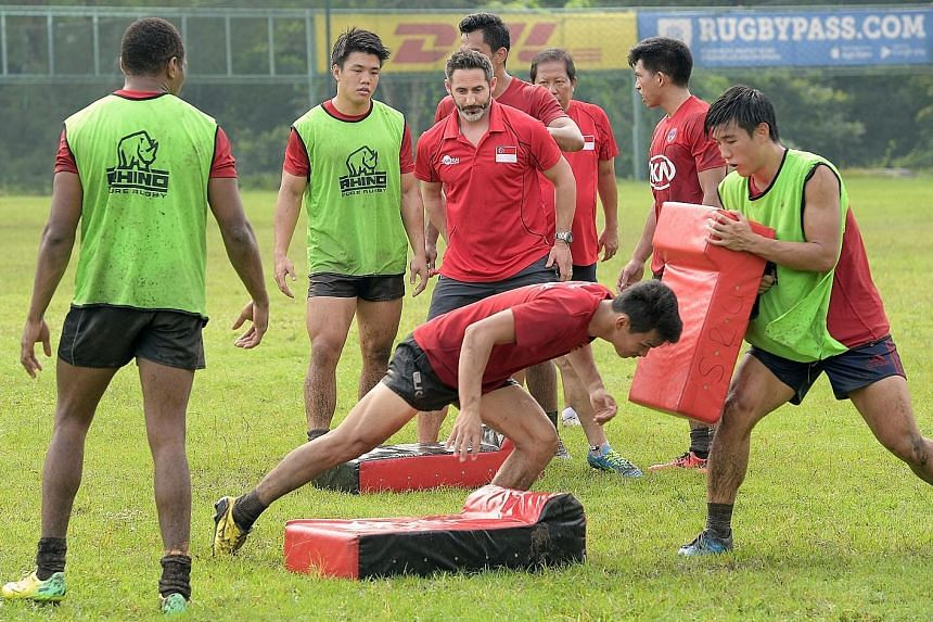 Retired English great Ben Gollings conducting training with the Singapore national rugby sevens team last Saturday at Turf City. The 14-man squad will head to Brisbane next Thursday for a four-day training camp.
