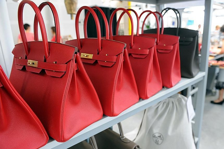 """Hermes' chief executive Axel Dumas said that the mood at the company is """"optimistic"""" and that sales momentum remained """"quite good"""" with sustained demand for the brand's Birkin (above), Kelly, Constance and Lindy bags, and robust demand for shoes, whi"""