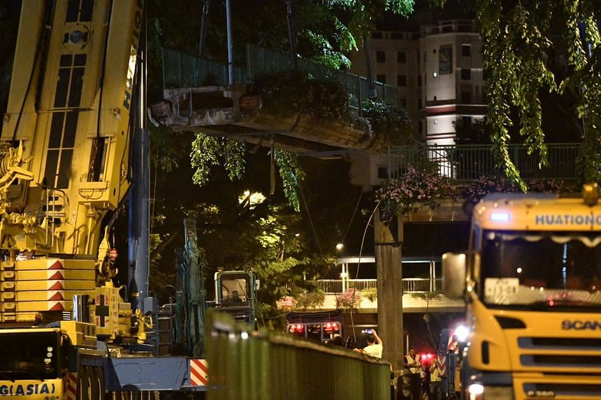 Half the overhead pedestrian bridge, which is about three road lanes in length, being removed just before 5am on July 22, 2017.