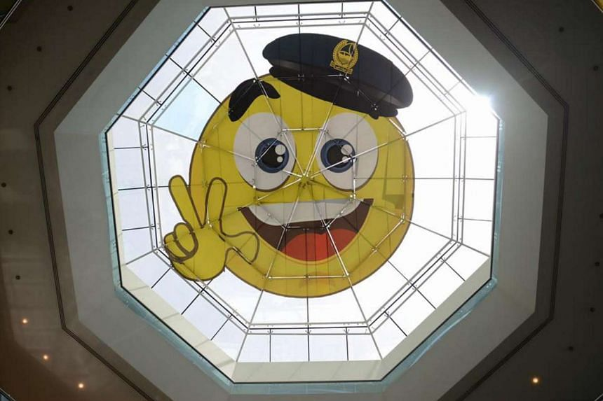 Officers in the Middle Eastern megacity unveiled the emoji-like symbol on the glass dome at the top of Al Muraqqabat Police Station on July 19, 2017.