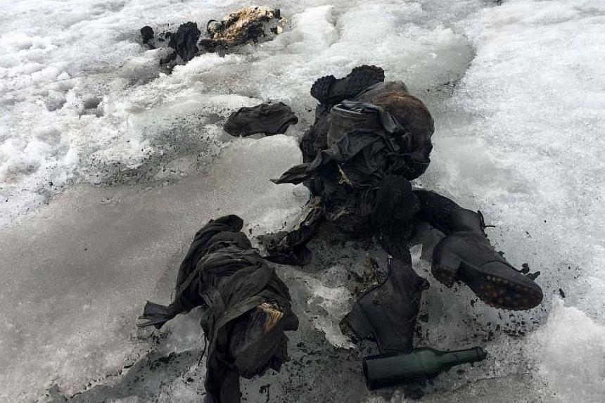 In an undated handout image, mummified remains found in a Swiss glacier, thought to be a farming couple who vanished in 1942.