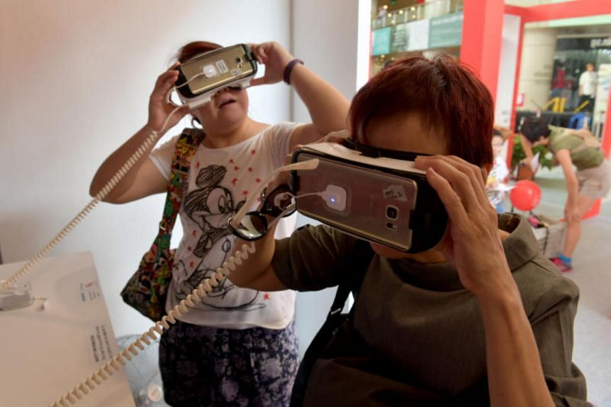 Visitors try out the VR goggles at the Singapore Discovery Centre travelling exhibition in Toa Payoh on July 22, 2017.