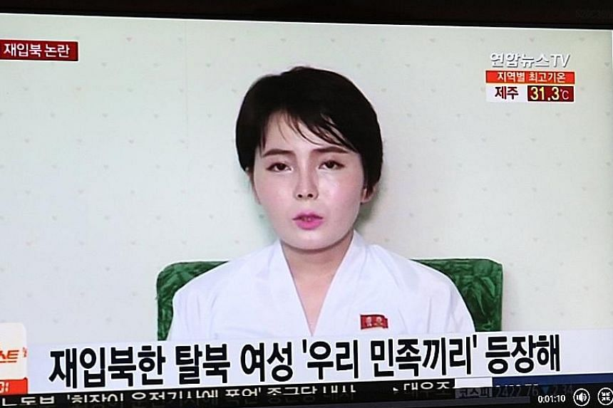 Left: A screengrab of Ms Im Ji Hyun in a show broadcast by South Korea's TV Chosun. Above: A news report on South Korean television last Wednesday showing Ms Im in the video allegedly taken after her return to the North.