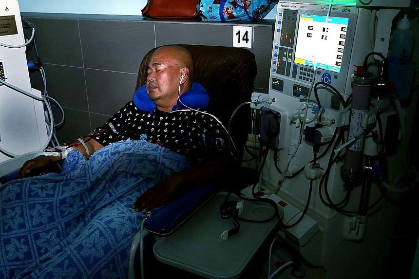 Mr Jais Minsawi undergoing night dialysis at the National Kidney Foundation's Hougang centre. Research shows that patients on nocturnal sessions were hospitalised less, gained more weight and had lower blood pressure when compared with those who unde