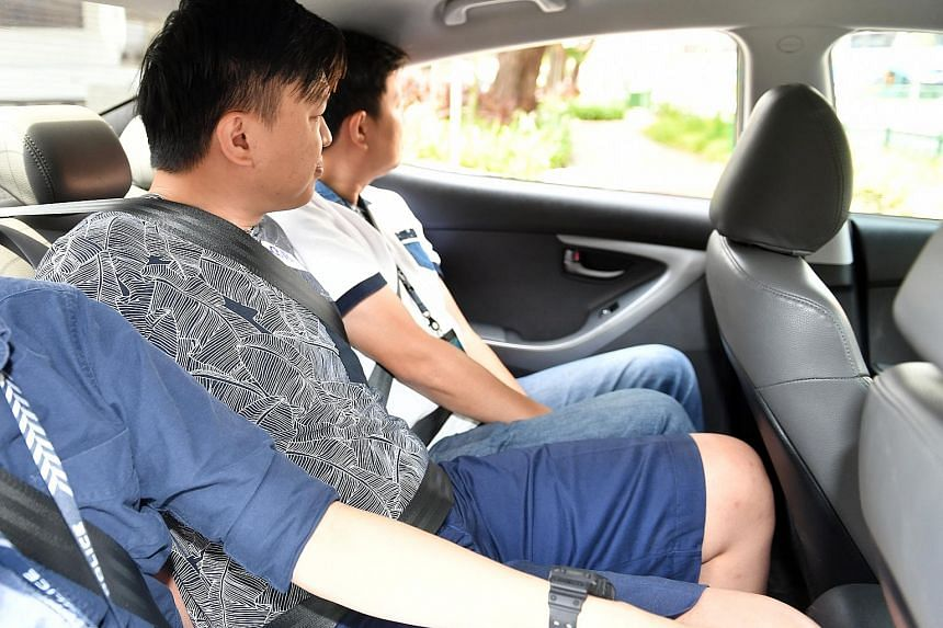 Saw Yan Long (centre) arriving at the State Courts yesterday escorted by two plain-clothes policemen. He is the first of 21 people who were nabbed in a police raid last Thursday to be charged. Two vice syndicates were crippled during the 12-hour raid