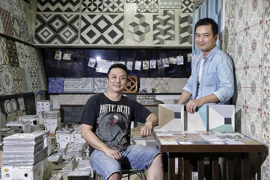 An Huat Trading director Lau Sze Siong (left) with Mr Mike Tay, designer of some of the tiles in the shop.