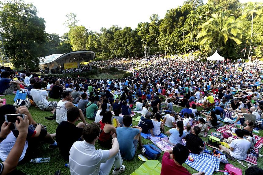 Young concertgoers also got to enjoy a good read as about 2,000 books were given out, sponsored by Scholastic. Attendees at The Straits Times Concert in the Gardens at the Singapore Botanic Gardens yesterday enjoyed an hour-long performance by the Si