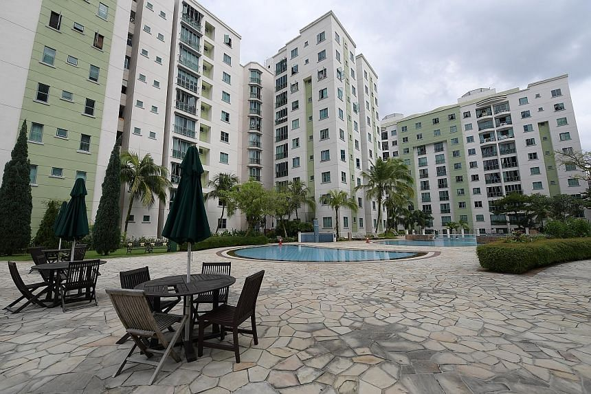 """Property investor Goh Kuan Keat in his Bukit Timah condo (right, bottom). Mr Goh, who has two children, says he likes investing in condominium units as it """"makes better financial sense... compared with landed property"""". Mr Goh's penthouse (top) in Ku"""