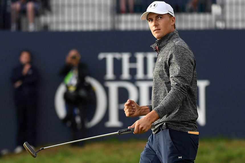 Jordan Spieth scores a birdie putt on the 18th during the third round of the British Open Golf Championships at Royal Birkdale, on July 22, 2017.