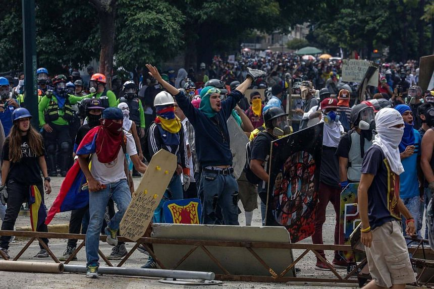 Opposition sympathizers clash with Venezuela security forces during a protest in Caracas, on July 22, 2017.
