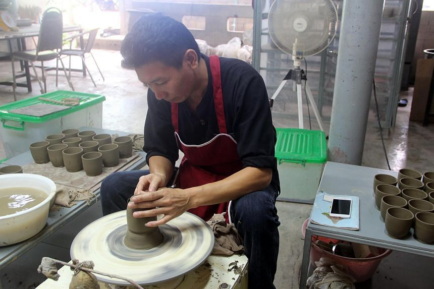 A craftsman working at Doi Tung's factory in Chiang Rai, northern Thailand.