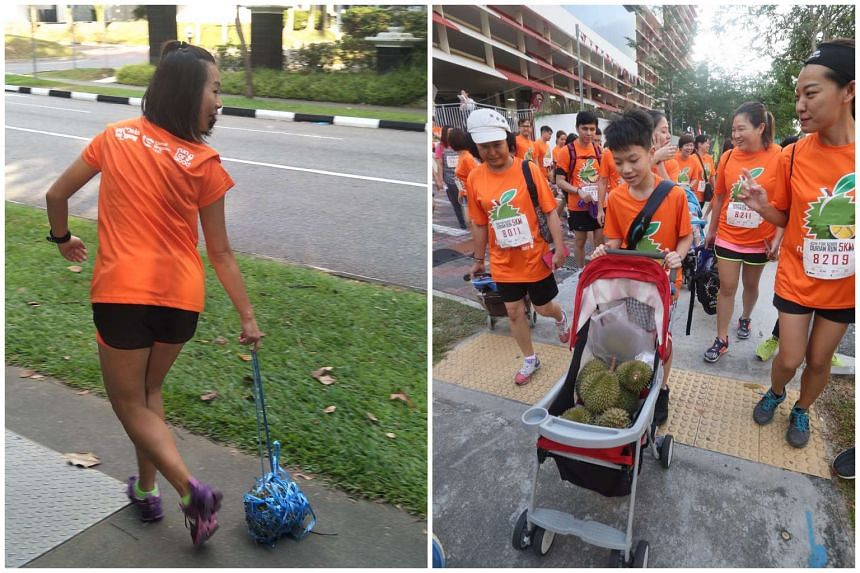 """Some participants chose to place the thorny fruit on their heads, drag it along with a homemade """"leash"""", or even ferry several durians in a pram."""