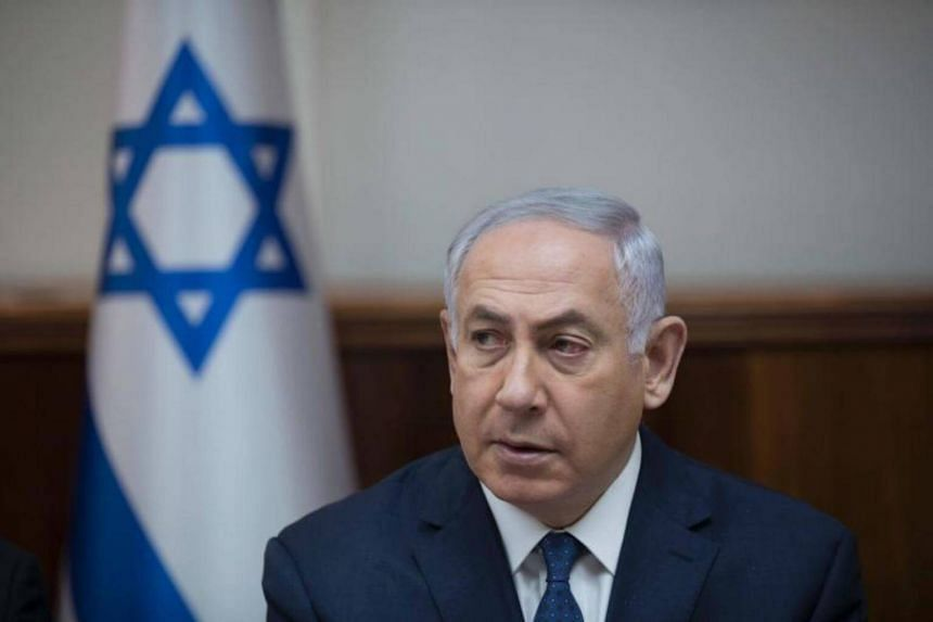 Israeli Prime Minister Benjamin Netanyahu attends the weekly cabinet meeting at his office in Jerusalem on July 23, 2017.