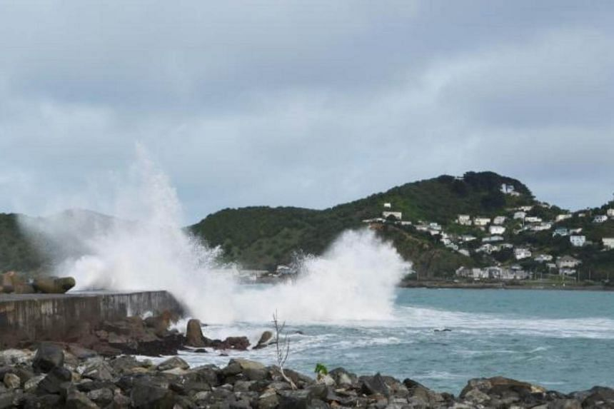 Huge waves lash Lyall Bay in the New Zealand capital Wellington on July 23, 2017.